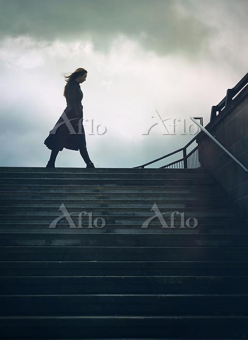 GIRL WALKING BY CITY STEPS IN ・・・