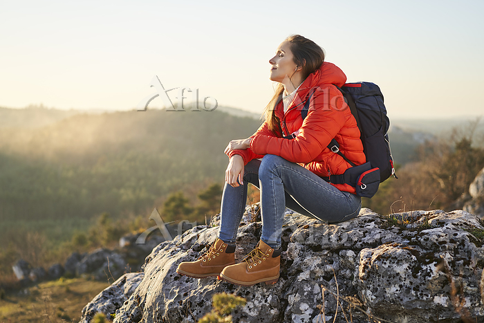 Woman on a hiking trip in the ・・・
