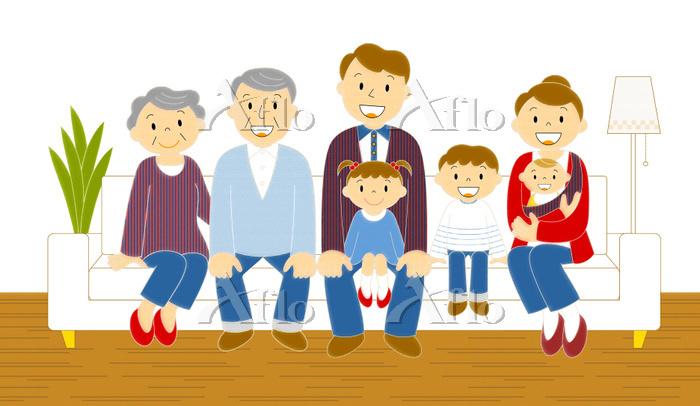 ソファーに座るデニムの三世代家族