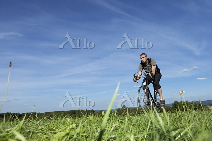 Man cycling in the country