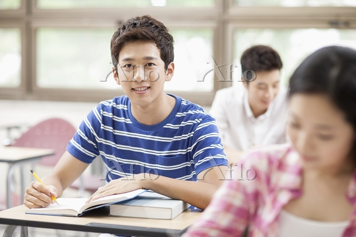 a man studying in class