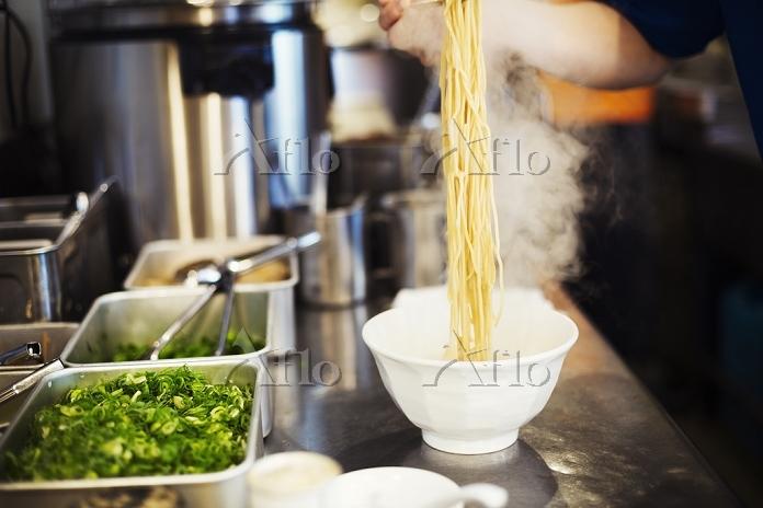A ramen noodle shop kitchen. A・・・