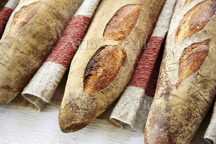 Three baguettes in a row on a ・・・