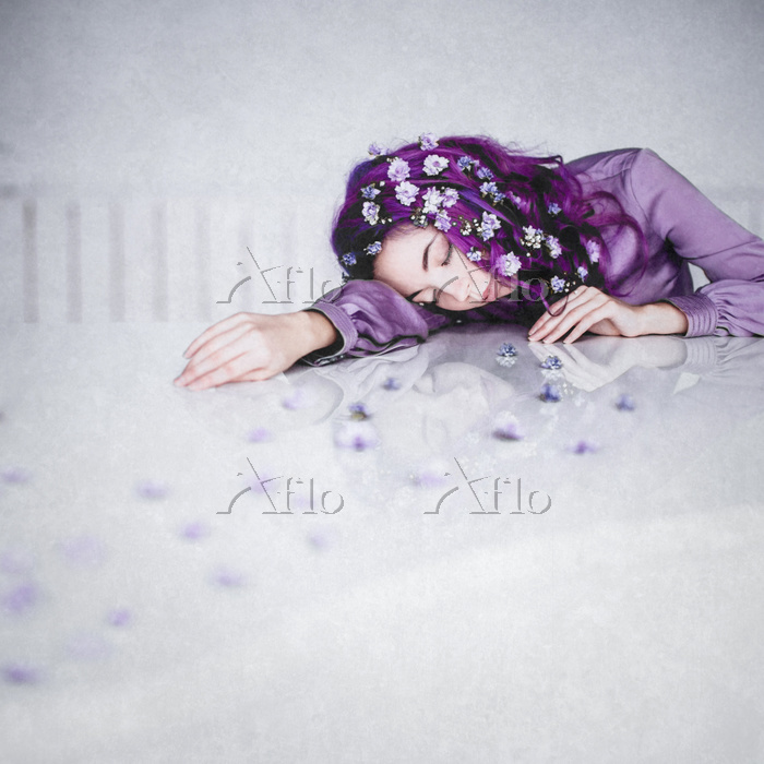 Young Woman With Purple Flower・・・