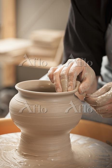a woman doing pottery