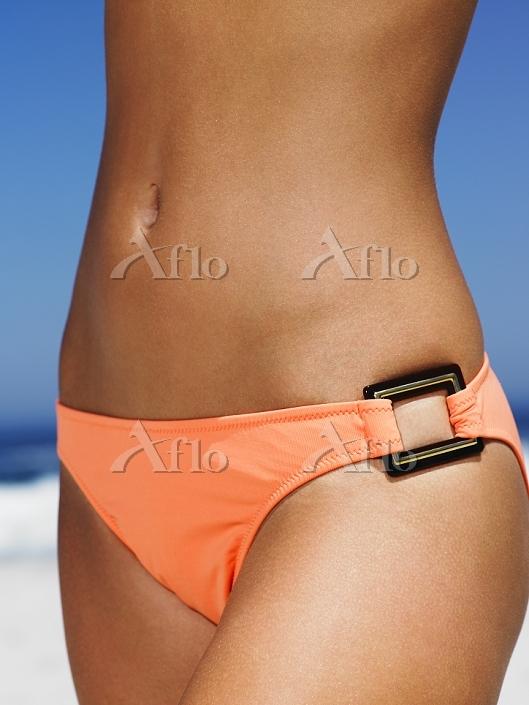 Body shot of girl on the beach・・・