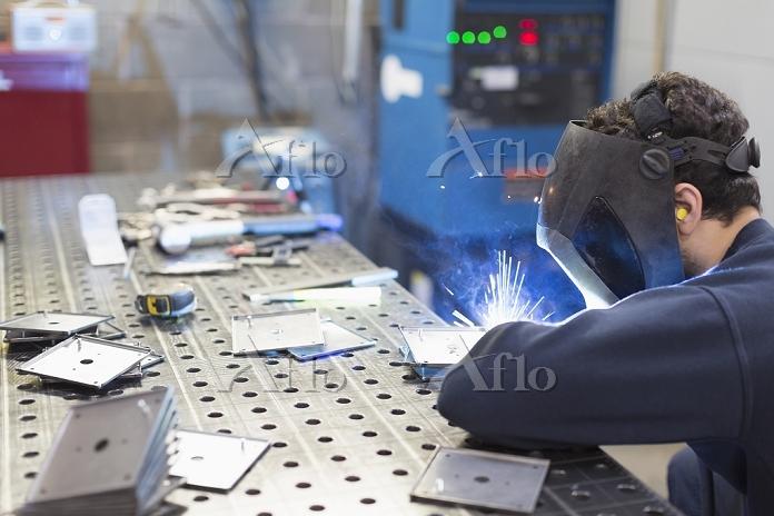Welder welding pieces in steel・・・