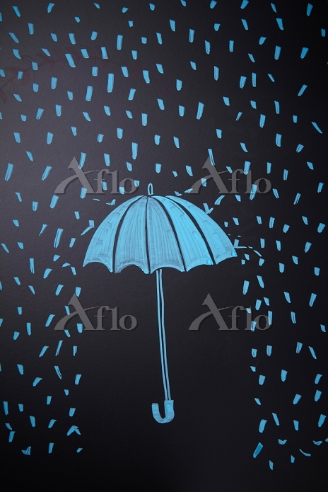 an umbrella and rain on a chal・・・