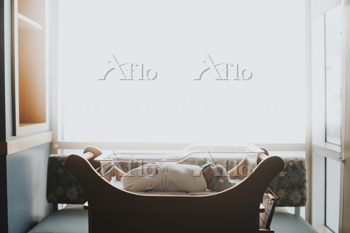 Side view of baby sleeping in ・・・