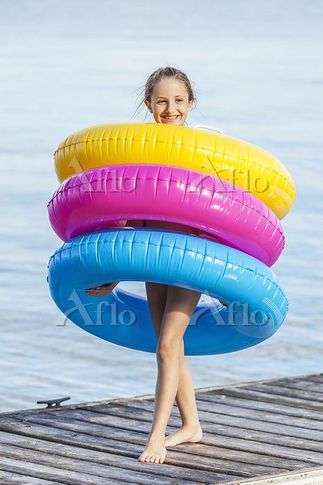 Girl Standing On Dock By Balsa・・・