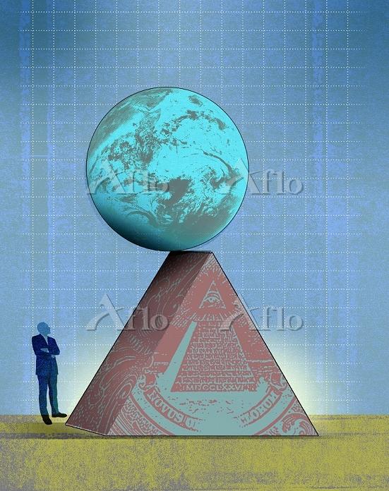 Man looking at globe teetering・・・