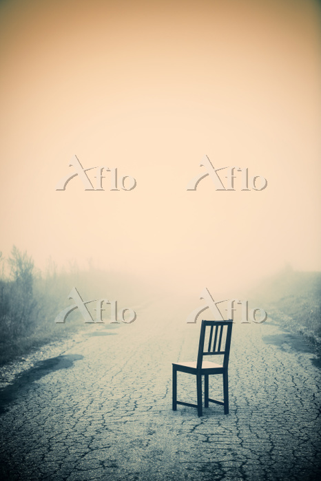 Chair On Foggy Country Road