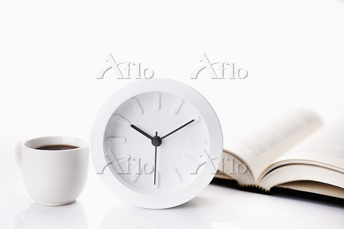 a book next to a clock and a c・・・