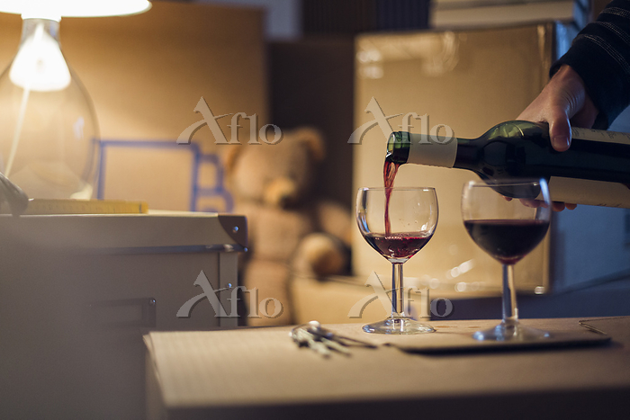 Hand pouring wineinto glasses ・・・