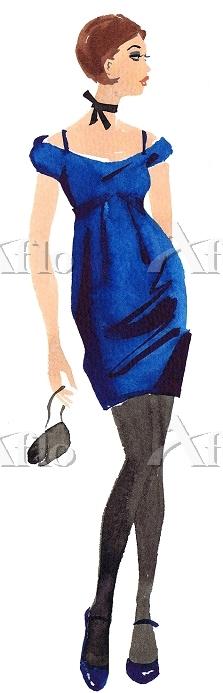 Woman wearing blue dress holdi・・・