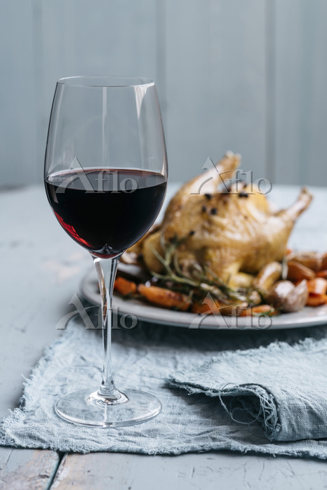 A glass of red wine with roast・・・
