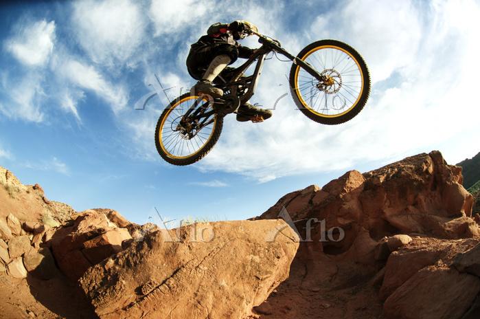 Mountain biker performing stun・・・