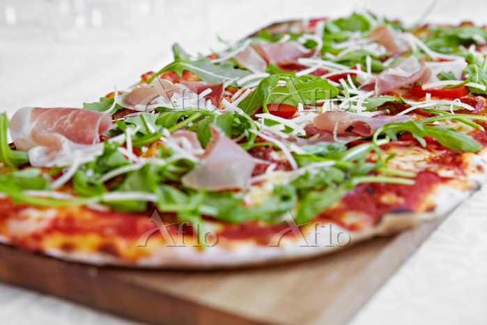 Fresh pizza with rocket and pa・・・