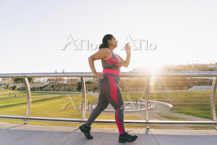 Side view of woman jogging on ・・・