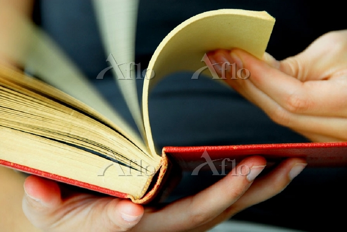 20 yr old woman flipping pages・・・