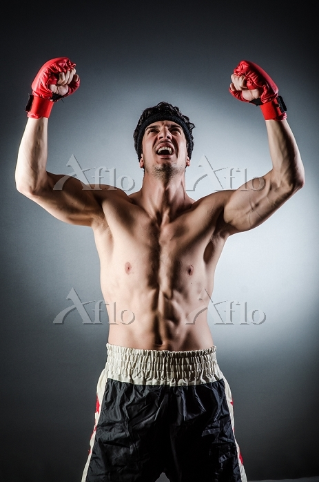 Muscular boxer wiith red glove・・・