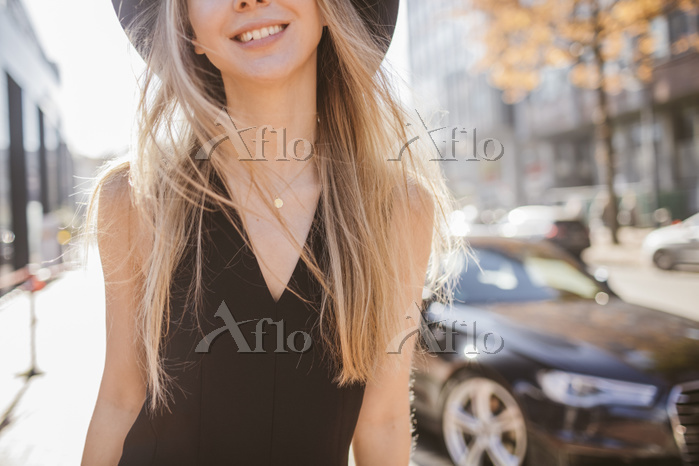 Laughing blond woman dressed i・・・