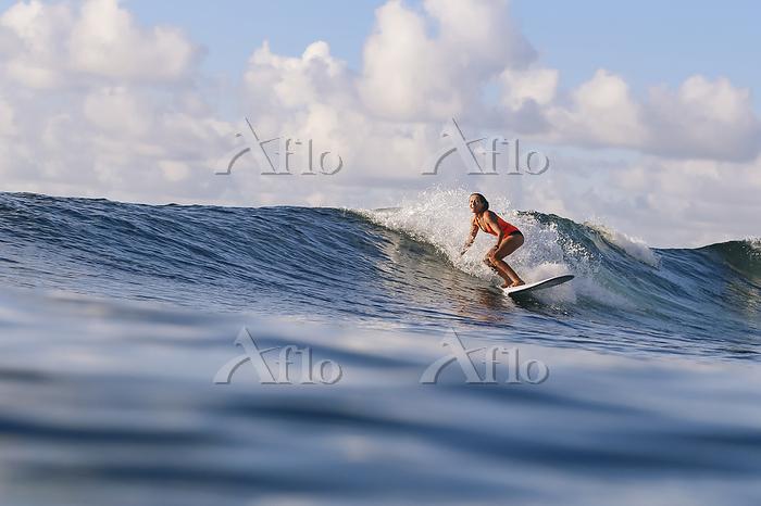 Female surfer on surfboard