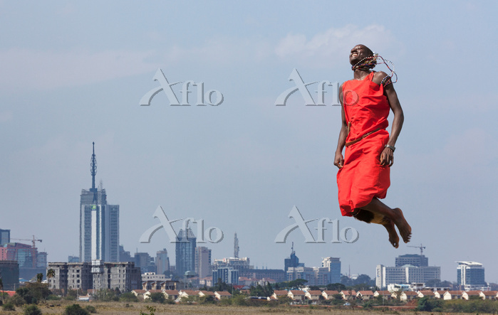 Masai warrior jumping in mid a・・・