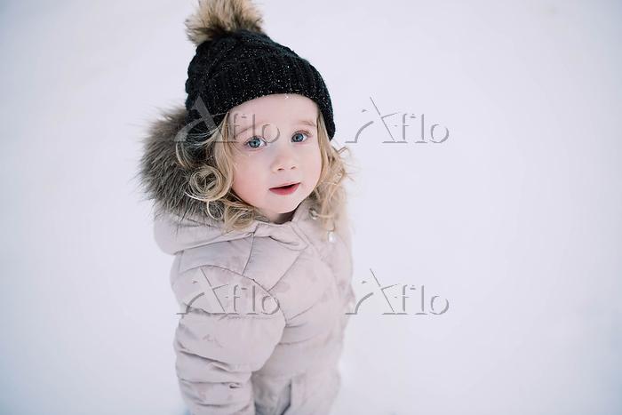 Little girl exploring the snow・・・