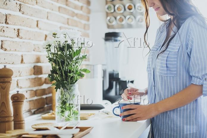 Caucasian woman stirring coffe・・・